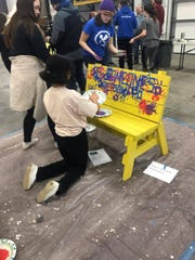 New Technology High students paint benches in February to give to elementary schools from the Greater Sioux Falls Habitat for Humanity. The benches will be delivered in April.