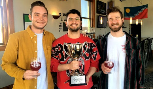 Evan Richards, Charlie Solomon, and Justin Kautz of Fernson Brewing Company, winners of the 3rd annual Downtown Sioux Falls Mash Madness competition.