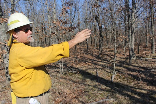 Nature Conservancy fire chief Tom Fielden gives a safety talk ahead of Monday's controlled burn at Bennett Spring Savanna Preserve.
