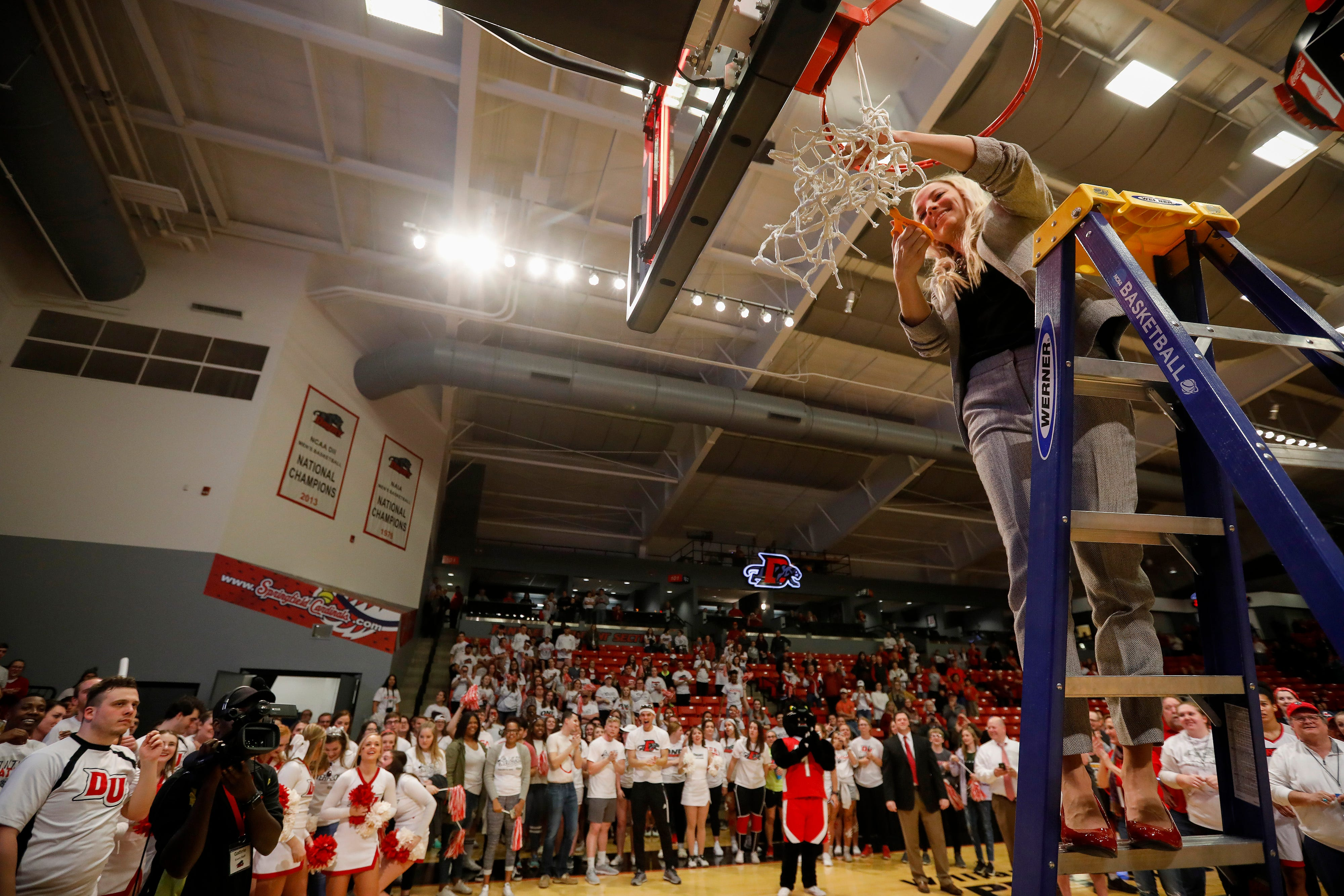 Drury head coach Molly Miller cuts down the net after winning the NCAA Division II Midwest Regional Championship game 51-44 over Grand Valley at the O'Reilly Family Event Center on Monday, March 18, 2019.