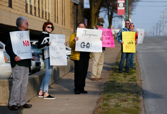 Eight protesters held signs Tuesday outside the Kraft Administrative Center, the headquarters for Springfield Public Schools. Inside, there was a school board meeting going on.