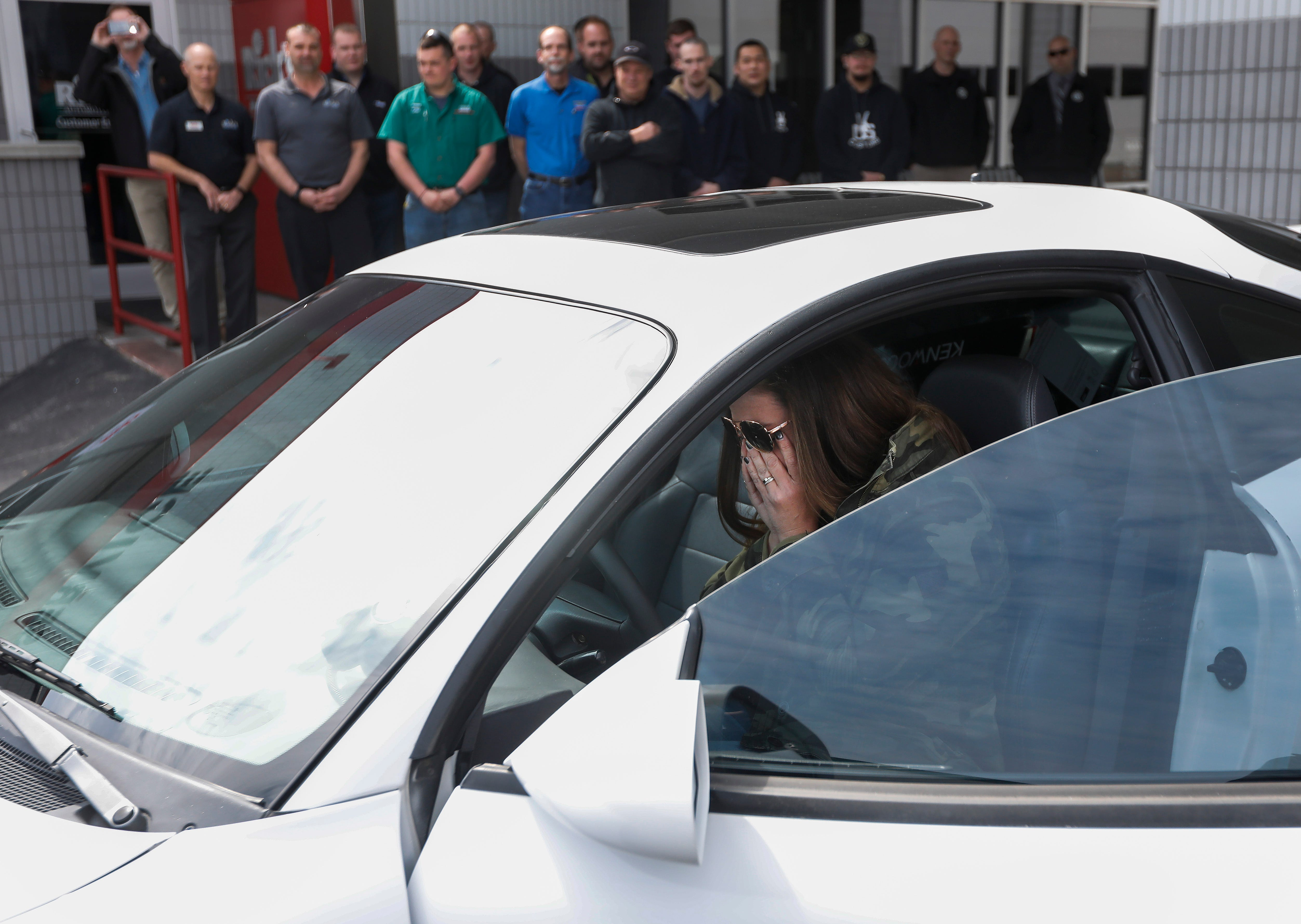 Kim Roberts, widow of Greene County Deputy Aaron Roberts, reacts after sitting in the 1995 Mitsubishi Eclipse that her husband was restoring before he died.