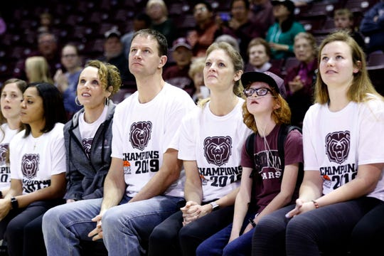 Elise Drennan sits with the Lady Bears coaches Monday as they awaited an announcement of their placing in the NCAA Tournament bracket.