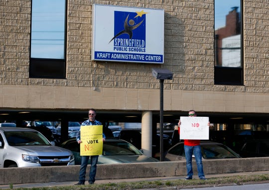 Protestors hold signs outside the Springfield Public Schools' Kraft Administrative Center on Tuesday, March 19, 2019, urging passerby's to vote no on Proposition S.