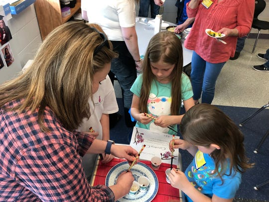 Students in Cassell Elementary's gifted and talented spent three weeks learning Mandarin before a recital March 15, where students showed off their language skills and guests practiced using chopsticks.
