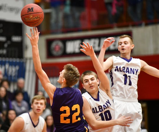 Grant Moscho of Melrose puts up a shot during the first half of the Friday, March 15, Section 6-2A championship game at Halenbeck Hall in St. Cloud.