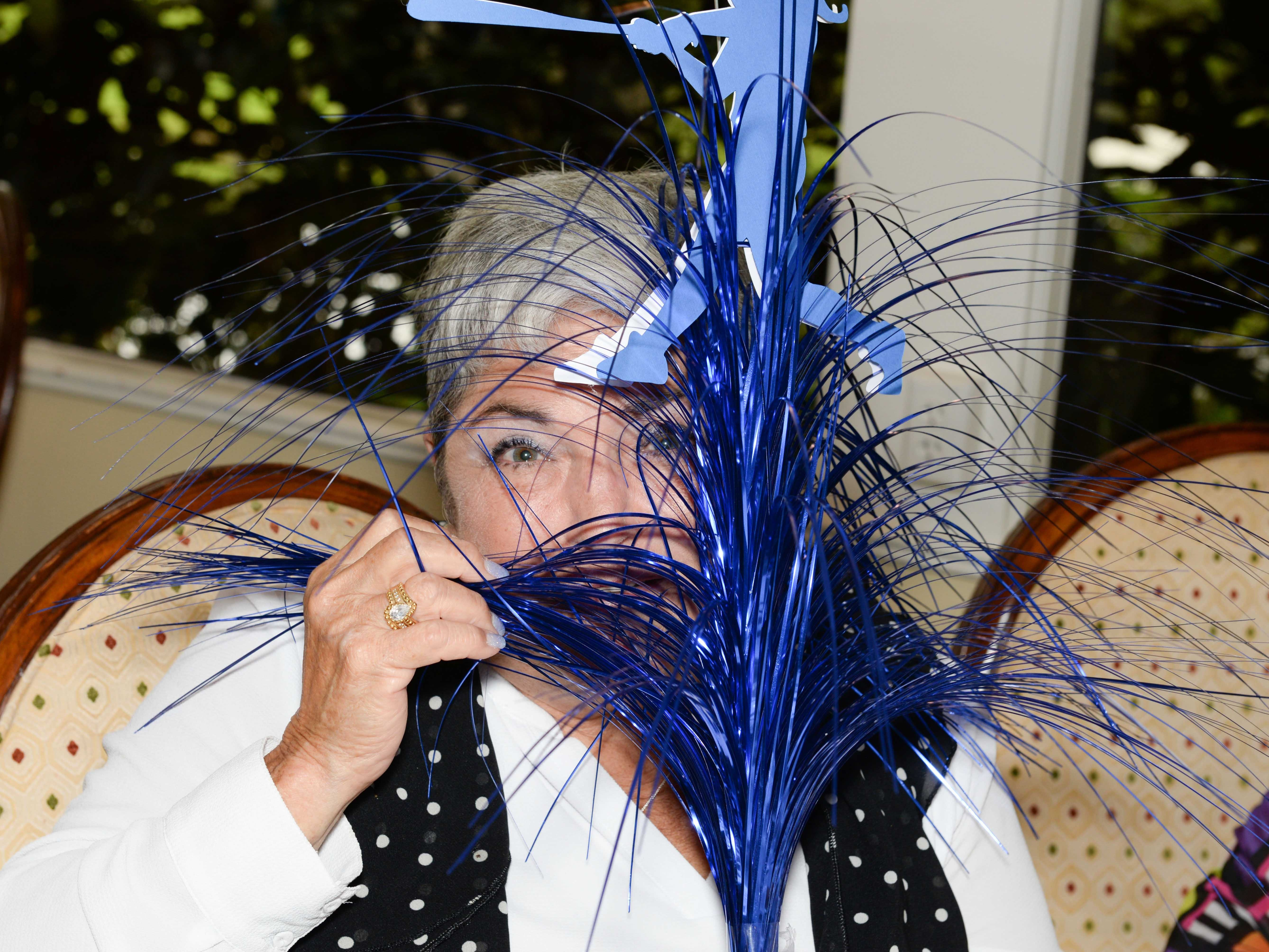 Tanya Shapiro has some some fun at the Stuart branch of the AAUW's 45th Anniversary luncheon and fashion show.