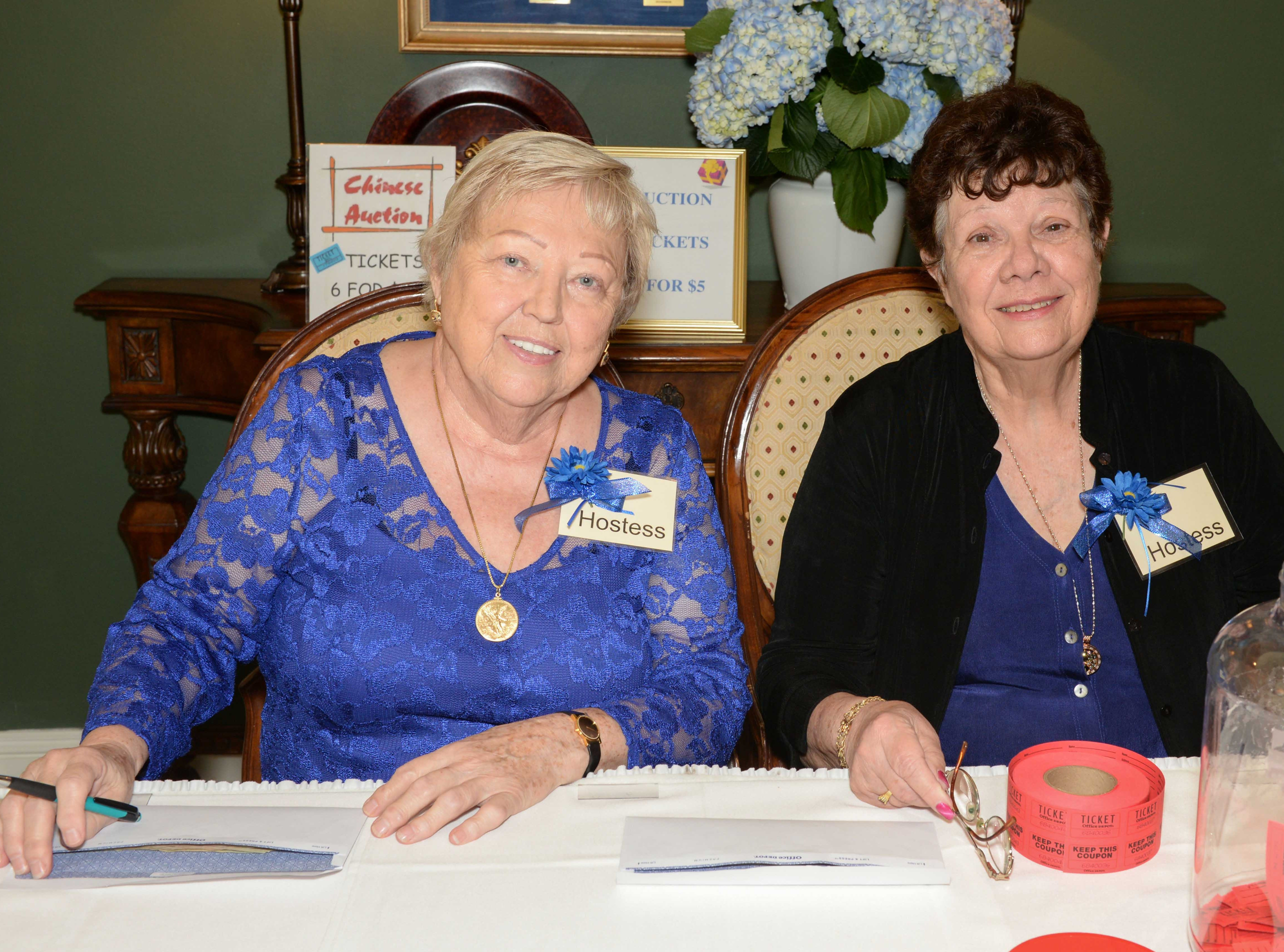 Helga Galli, left, and Mary Brower sell Chinese auction tickets at the Sapphire Anniversary party of the American Association of University Women Stuart Branch.