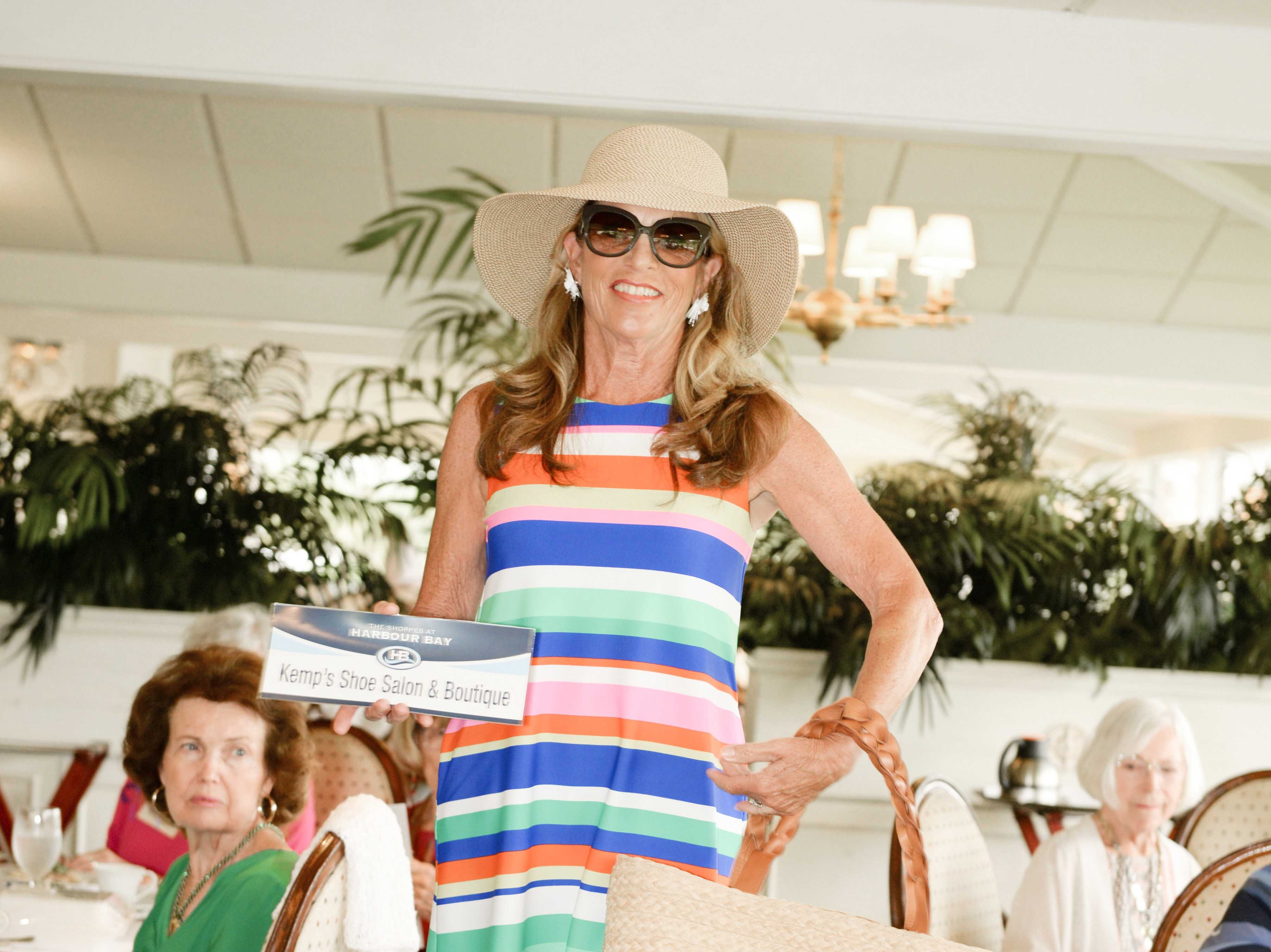 Jane Harlan models an outfit and shoes from Kemp's Shoe Salon & Boutique at the American Association of University Women Stuart Branch's luncheon and fashion show.