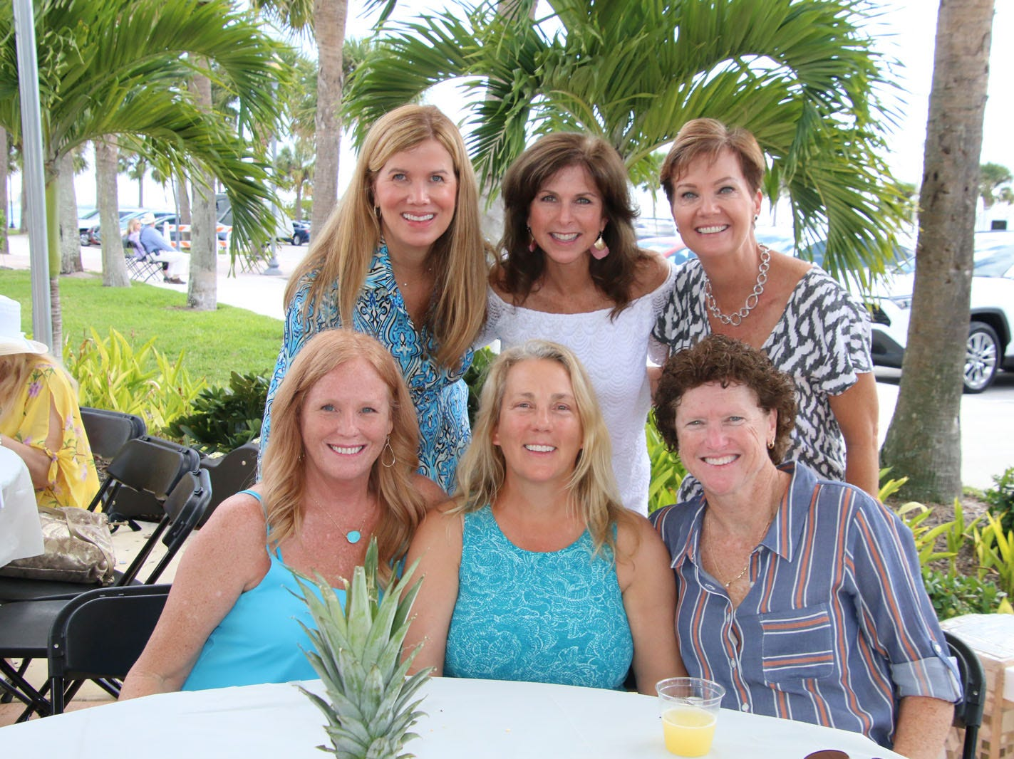 """Mary Radabaugh, seated, left, Meg Enns, Kathy Harris Rankine, with Kim Ponsoldt, standing, Lisa Brown and Carrie Green at the Backus Brunch at  A.E. """"Bean"""" Backus Museum & Gallery in Fort Pierce."""