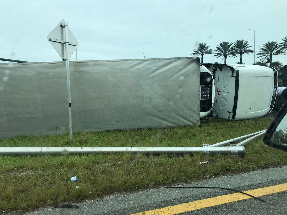 A tractor-trailer flipped onto its side at State Road 60 ramp onto Interstate 95 March 19, 2019.