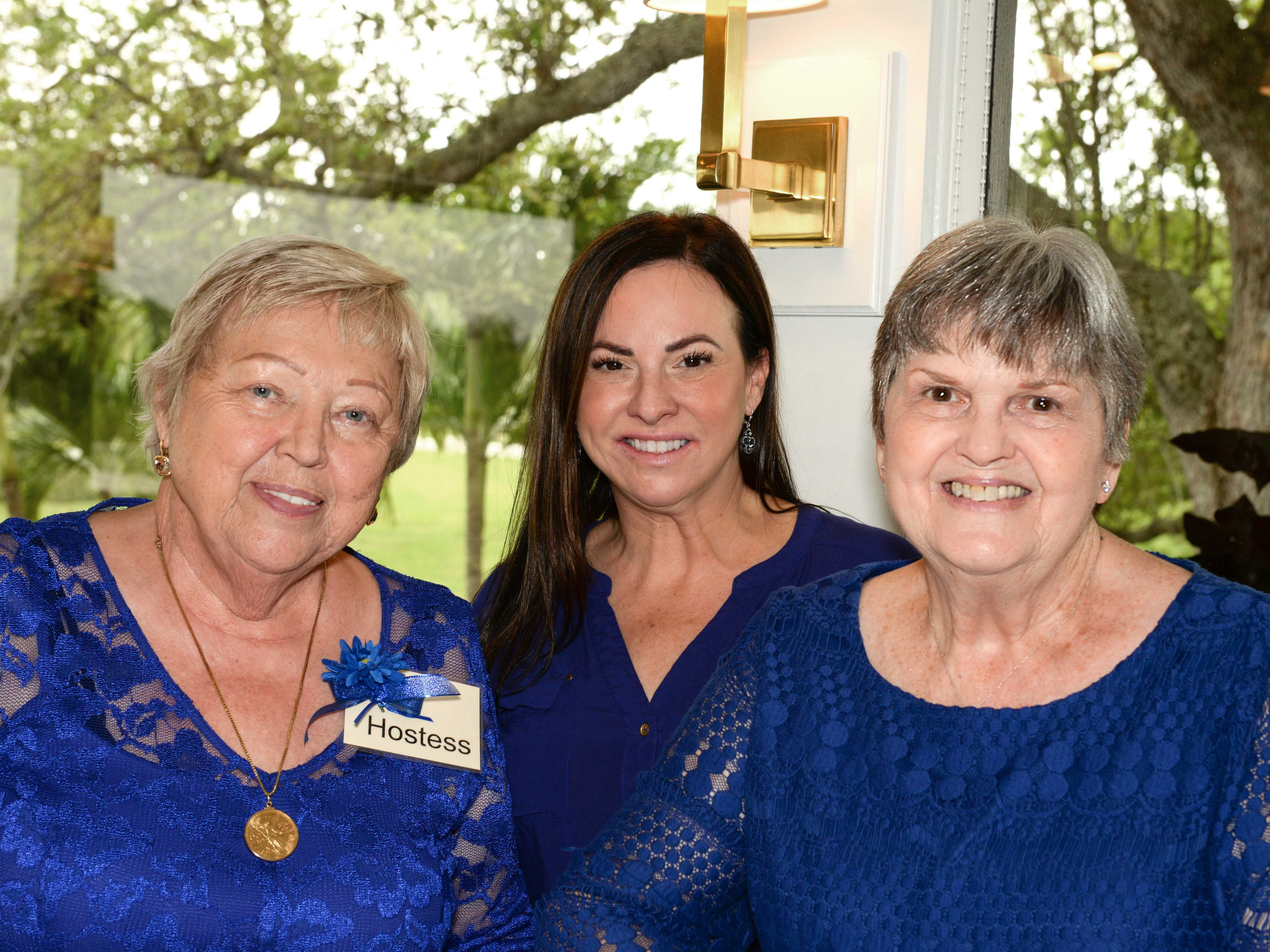 Helga and Michele Galli, left, and Mary Wilburn at the Stuart branch of the AAUW's 45th Anniversary luncheon and fashion show.