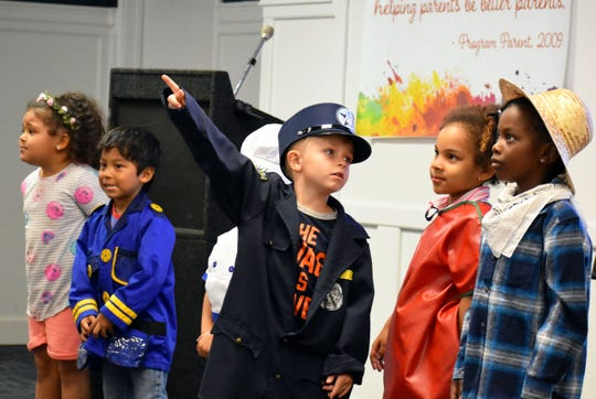 Members of Marilyn Brock's 4-year-old class at the Childcare Resources School, from left, Cathryn, Nicolas, Skyler, Ava and Aleah perform at the 25th anniversary celebration.