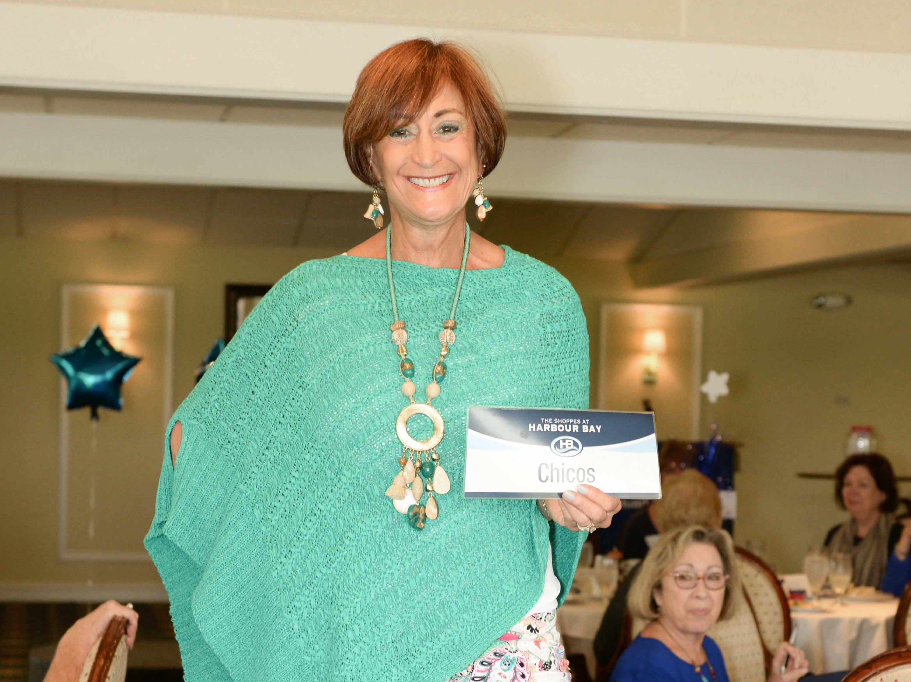 Janie Copes models an outfit from Chico's at the American Association of University Women's 45th Anniversary luncheon and fashion show.