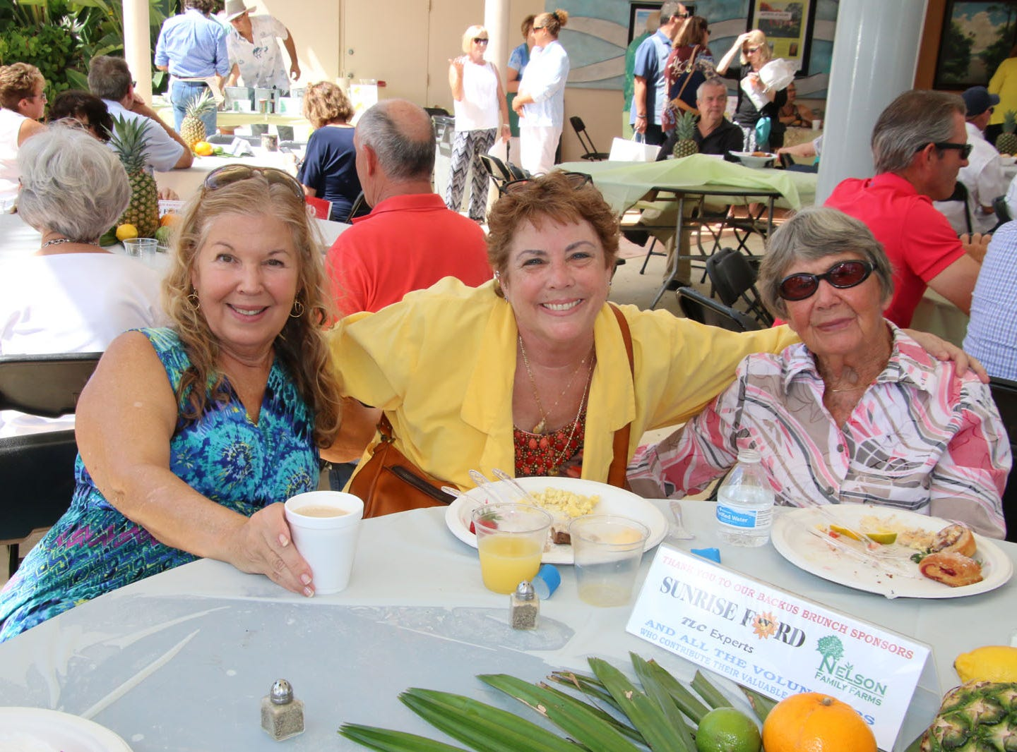 """Judy Brennan, left, Lauren Newsome and Dorothy Brennan at the Backus Brunch at  A.E. """"Bean"""" Backus Museum & Gallery."""