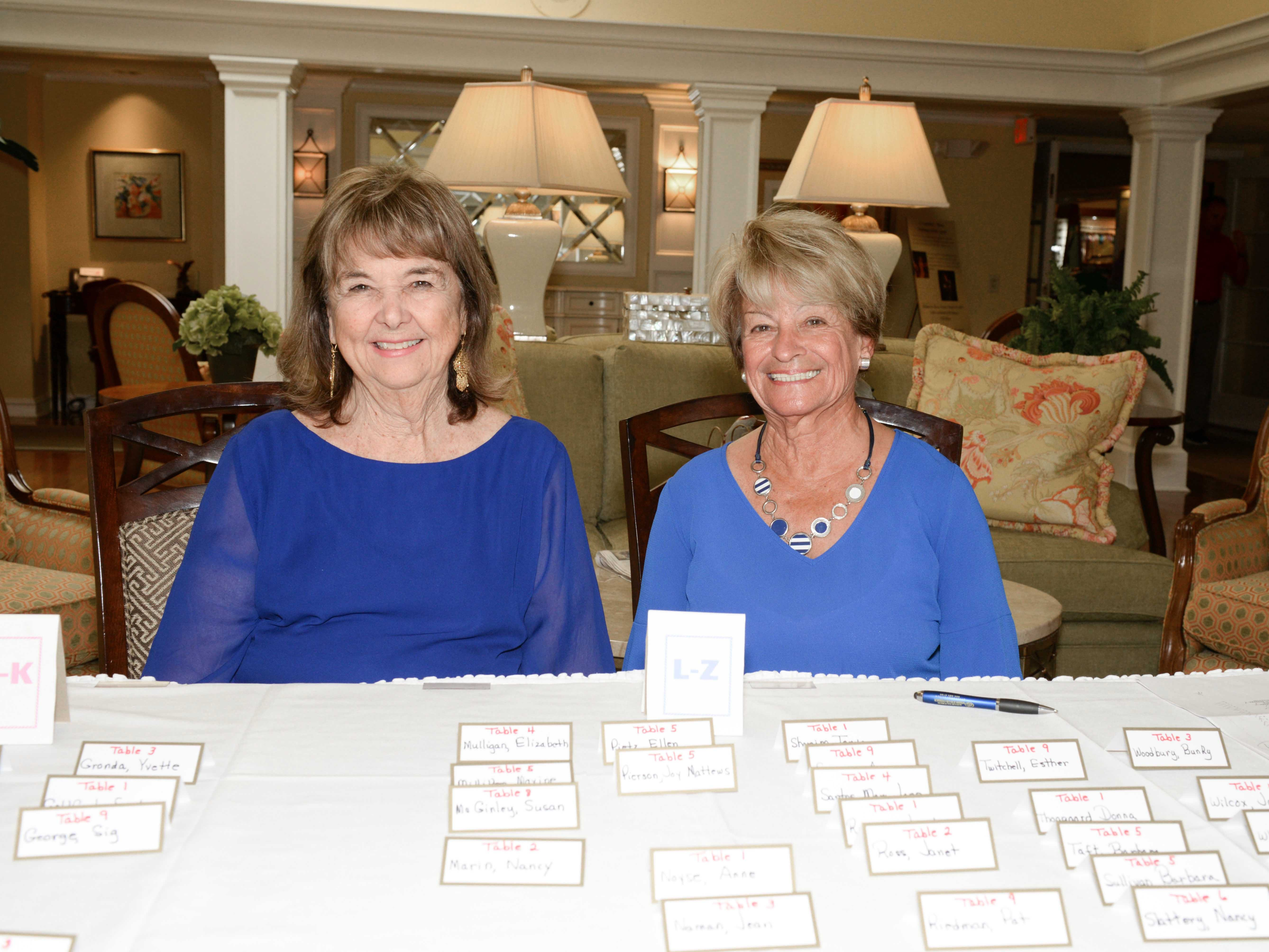 Nancy Erwin, left, and Rosemary Villano at the registration table at the Sapphire Anniversary party of the American Association of University Women Stuart Branch.