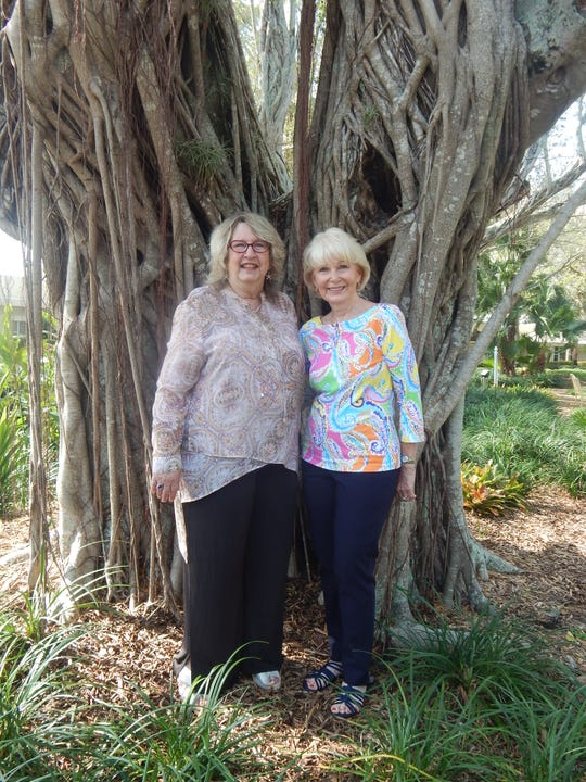 Helping People Succeed President/CEO Suzy Hutcheson, left, with Joy Funston, a resident of Sandhill Cove.