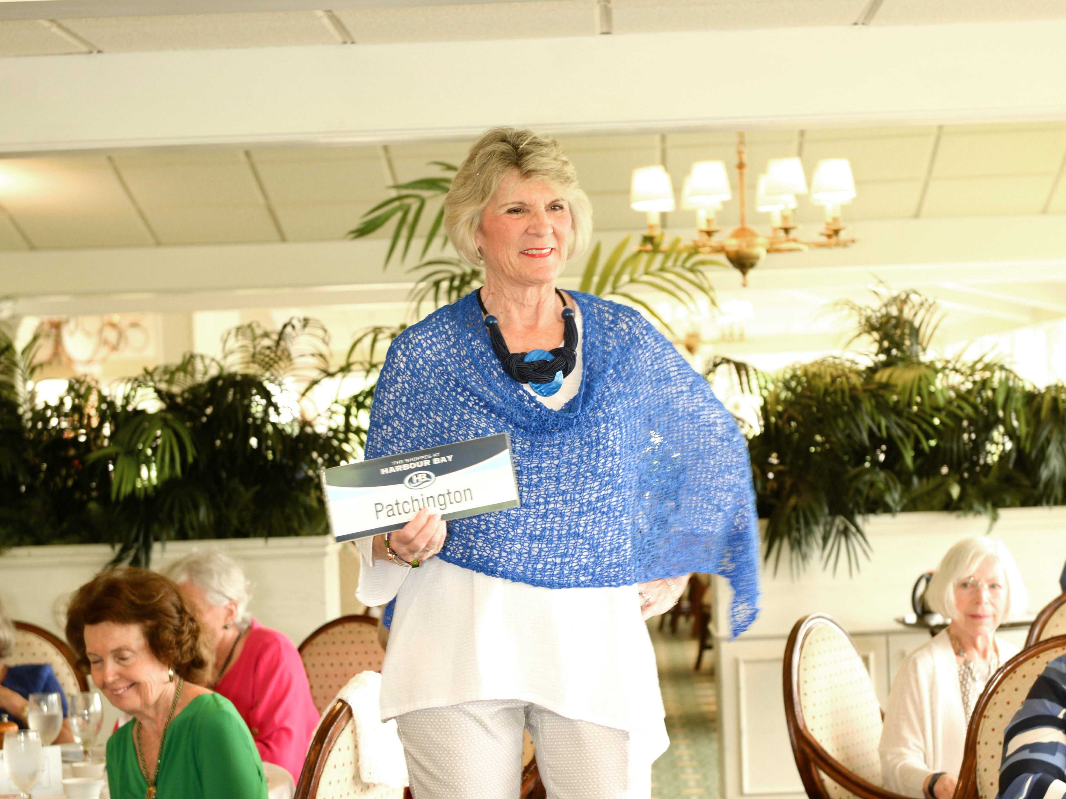 Pat Miller models an outfit from Patchington at the Sapphire Anniversary party of the American Association of University Women Stuart Branch.