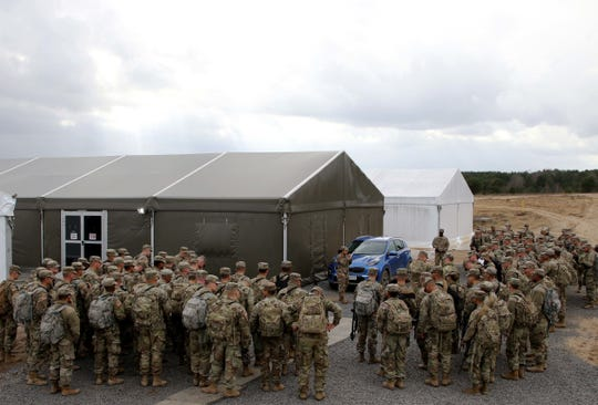 Soldiers with 1st Battalion, 35th Armor Regiment, 2nd Armored Brigade Combat Team, 1st Armored Division from Fort Bliss, check in for roll call after arriving at Drawsko Pomorskie Training Area, Poland. The soldiers are in Poland to test their unit readiness as part of an emergency deployment readiness exercise. About 1,500 soldiers deployed to Europe in support of the exercise to test the U.S. Army's ability to rapidly alert, recall and deploy under emergency conditions.