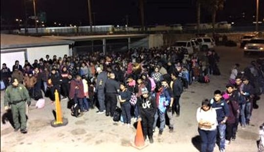 One of two large groups of Central American migrants detained early Tuesday in El Paso.