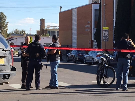 El Paso police armed with rifles seal off Lydia Patterson Institute on Tuesday, March 19, 2019, during a search for a gunman who seriously wounded a person. A suspect was arrested.