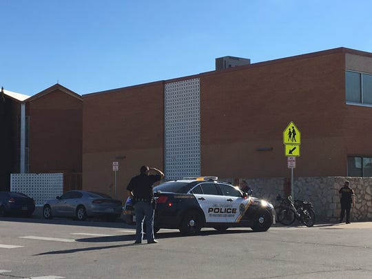El Paso police Tuesday evening seal off the area around Lydia Patterson Institute after a shooting left a person with life-threatening injuries. A suspect was seen fleeing onto the school's grounds, police said. He was later arrested.
