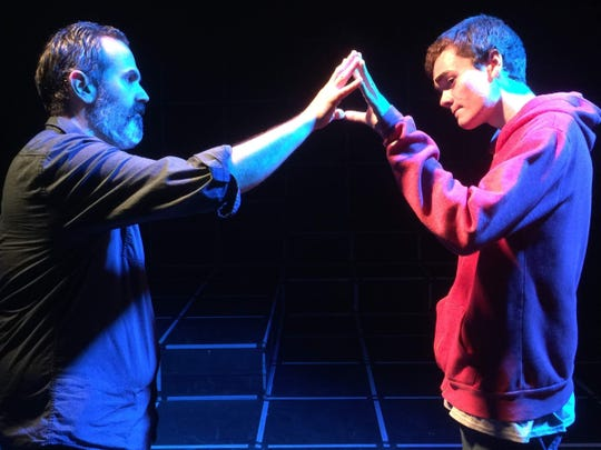 "Ed, played by Jeff Ham, attempts to connect with his son, Christopher Boone, played by Benjamin Colby Wilson, in the Ventura County premiere of ""The Curious Incident of the Dog in the Night-Time."""