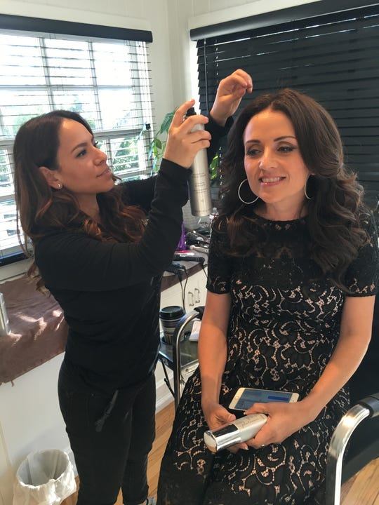 Sherman Oaks hairstylist Ivonne Herrera works on a client's hair in an undated photo. Herrera, 37, is an independent contractor who travels throughout Ventura County and Los Angeles County for her job.