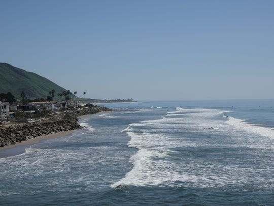 Waves roll toward Hobson Beach Park along Pacific Coast Highway north of Ventura.