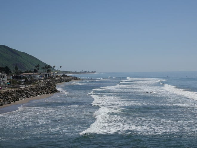 Waves roll toward Hobson Beach Park along Pacific Coast Highway north of Ventura.