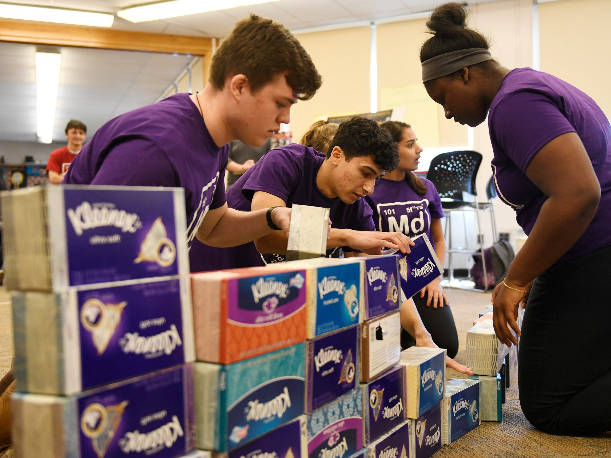 Students try to build the periodic table out of tissue boxes within a set time during a special event celebrating the 150th anniversary of the creation of the Periodic Table at Vineland High School on Tuesday, March 19, 2019.