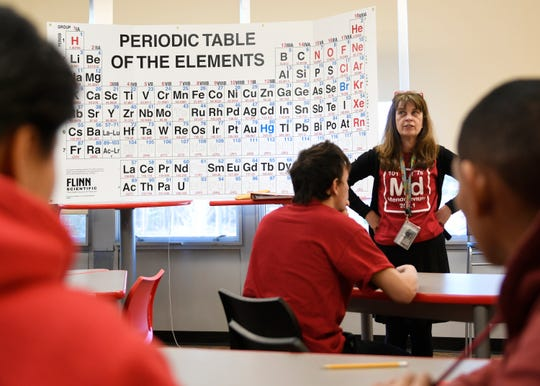 Vineland High School science teacher Vicki Yeager quizzes students on the Periodic Table at a special event in the school's library on Tuesday, March 19, 2019.