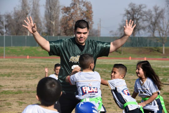 Correctional Deputy Jonathan Hernandez helps out Jan. 19, 2019 during half-time of the Call of Duty kick-off game for the Sheriff's new NFL Flag Football League at Groppetti Community Stadium on the campus of Golden West High School in Visalia.