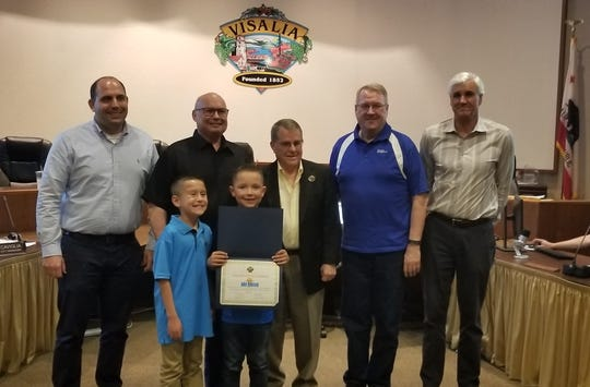 "Visalia City Council honors  Jake Robison, 9, with a ""certificate of courage"" for saving his friend, Colton Domingues' life."