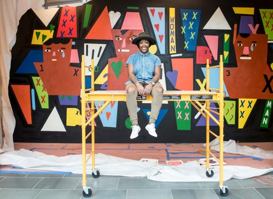 Nina Chanel Abney in front of one of her murals at The Nasher Museum at Duke University. Her work is on display at the Neuberger Museum of Art in Purchase.