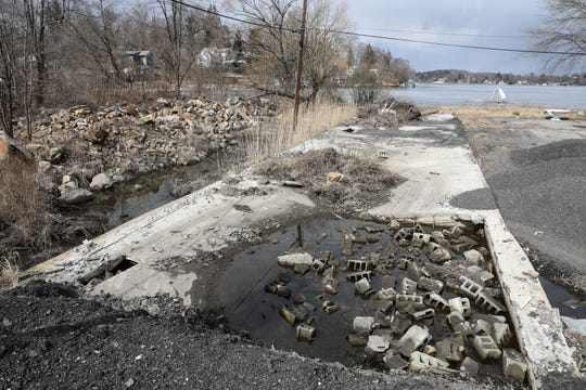 A section of Swan Cove in Mahopac photographed on Tuesday, March 19, 2019, has piles of construction debris left on the site.
