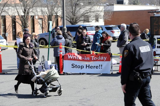 Advocates for write-in candidates outside Ramapo Town Hall during Election Day March 19, 2019 in Airmont.