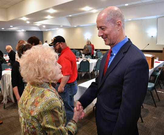 Dorothy Rhone visits with U.S. Congressman Mac Thornberry Tuesday after he spoke at the Wichita County Republican Women's lunch.