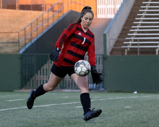 Wichita Falls High School's Zoe Brewster punts in the match against Rider Monday, March 18, 2019, at Memorial Stadium. The Lady Raiders defeated the Lady Coyotes 3-1 to take the district championship.
