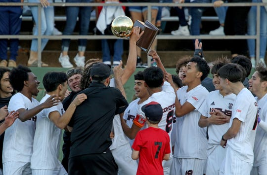 Wichita Falls High School celebrates their district championship after a win over Rider Monday, March 18, 2019, at Memorial Stadium.