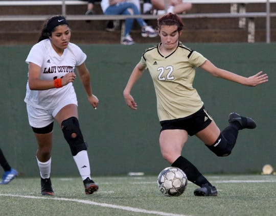 Rider's Salty Jackson passes in the match against Wichita Falls High School Monday, March 18, 2019, at Memorial Stadium. The Lady Raiders defeated the Lady Coyotes 3-1 to take the district championship.