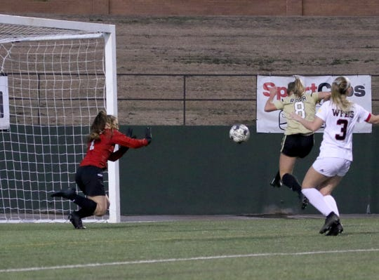 Rider's Devon Browning scores the first goal of the match against Wichita Falls High School Monday, March 18, 2019, at Memorial Stadium. The Lady Raiders defeated the Lady Coyotes 3-1 to take the district championship.