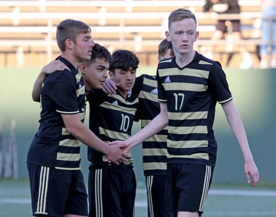 Rider's Jackson Redding returns to his teammates after missing the fist penalty kick against Wichita Falls High School Monday, March 18, 2019, at Memorial Stadium.