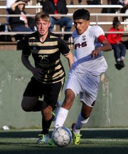 Wichita Falls High School's Alonso Cerna dribbles in the match against Rider Monday, March 18, 2019, at Memorial Stadium. The Coyotes defeated the Raiders 5-4 in PKs to take the district 4-5A championship.