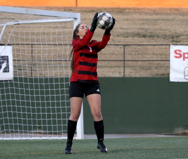 Wichita Falls High School's Zoe Brewster makes a save  against Rider Monday, March 18, 2019, at Memorial Stadium. The Lady Raiders defeated the Lady Coyotes 3-1 to take the district championship.