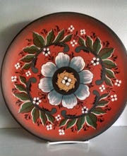 Jerry Apps' brother-in-law Clarence Olson did rosemaling on this plate. Rosemaling, a Norwegian folk art, is also known as rose painting and brightened many a household in Norway.