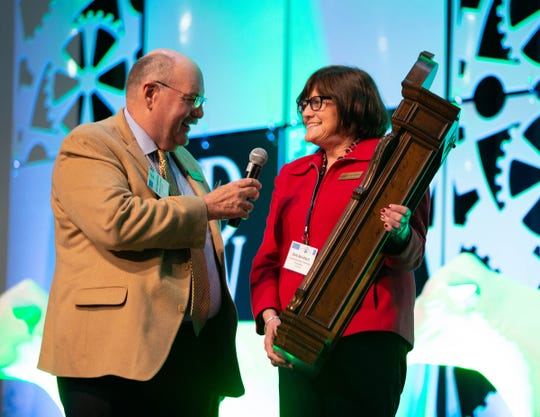Deb Reinhart, Executive Director of Professional Dairy Producers Foundation, was recognized for her years of service to the dairy industry and her influential role in establishing, volunteering for, and managing the foundation since its creation. John Kappleman is pictured with Reinhart.