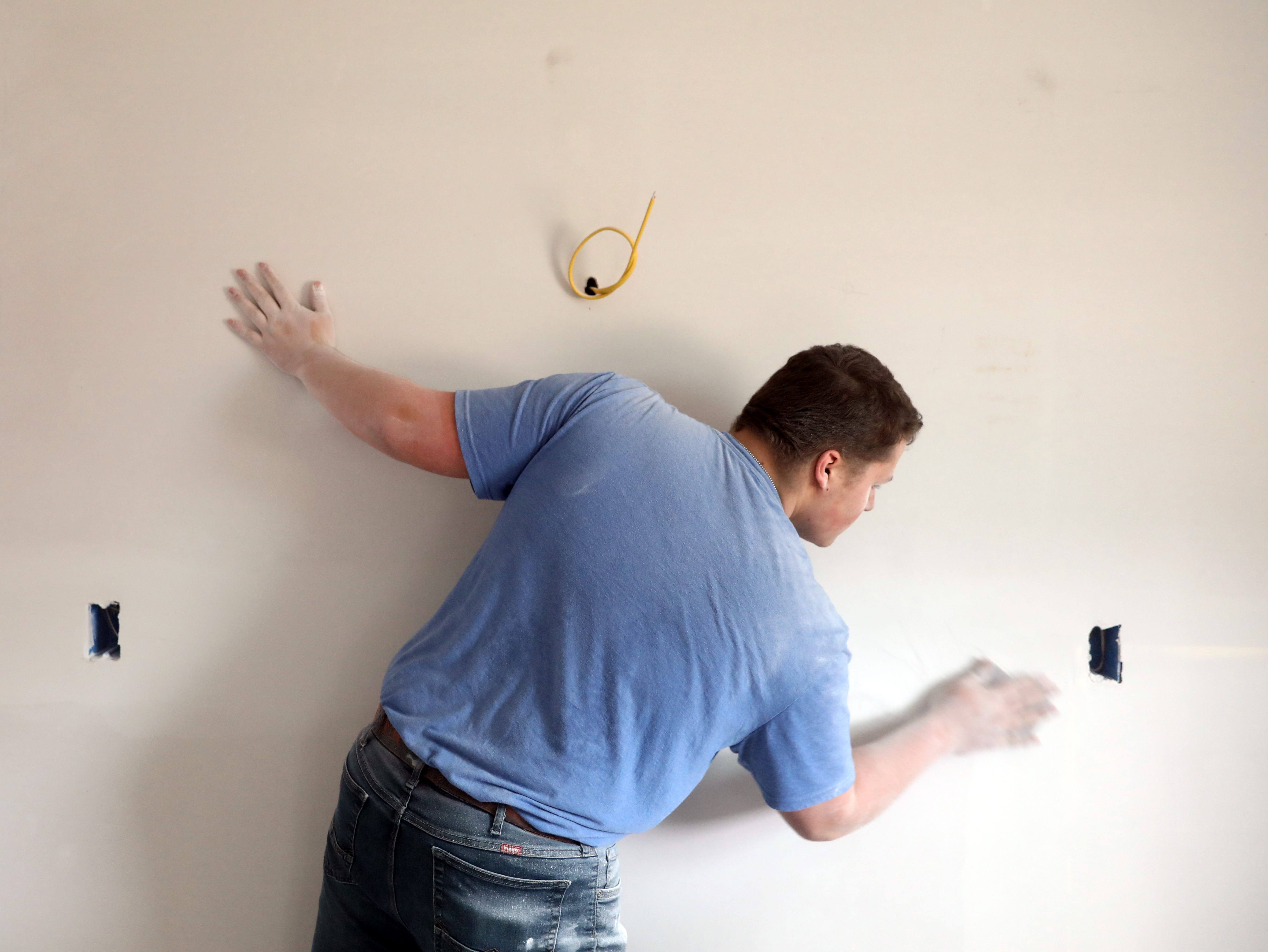 Darren Gates, a Mid-East student from Maysville High School, works on drywall in a house the carpentry program Mid-East Career and Technology Center is building for Habitat for Humanity.