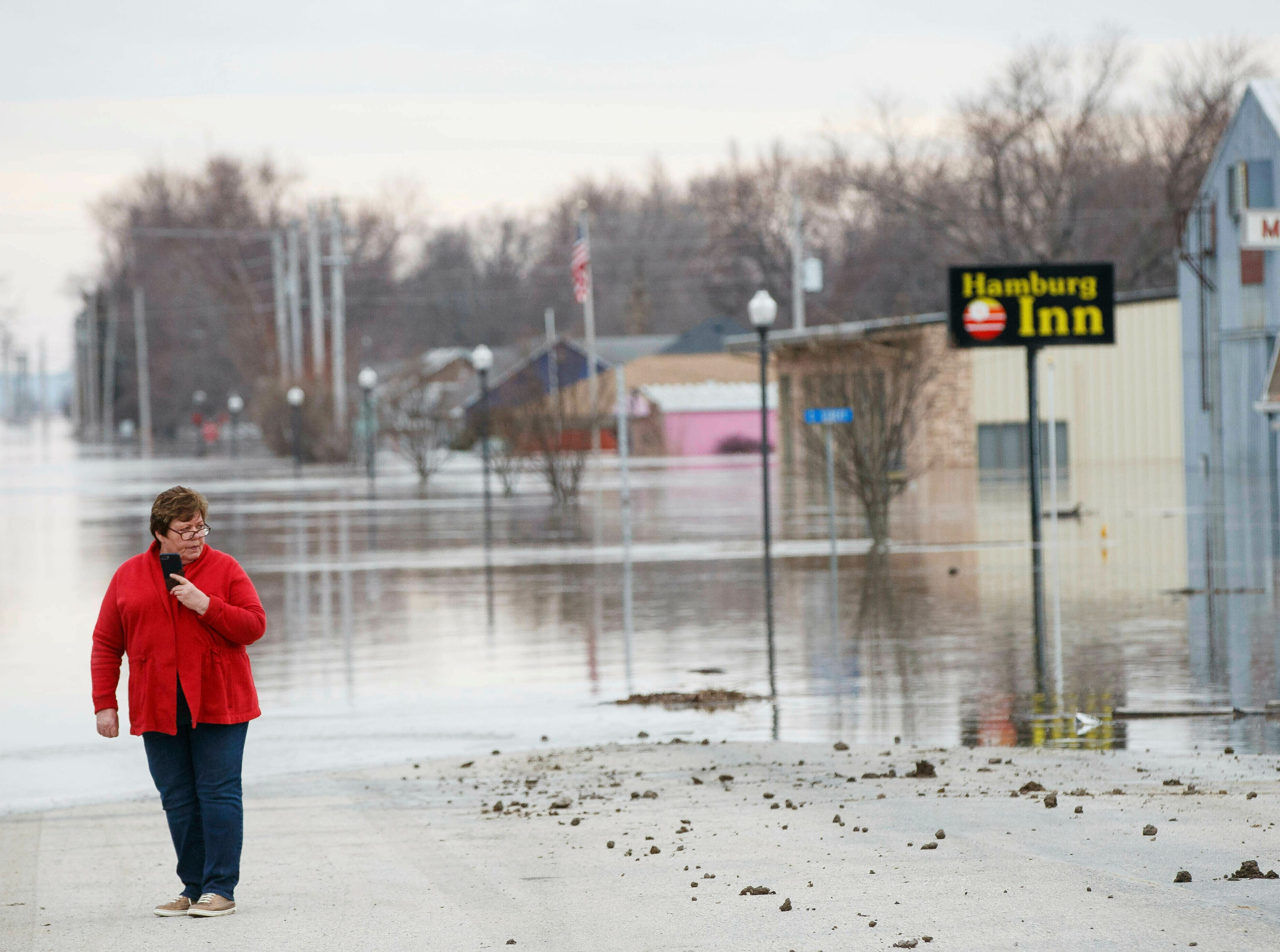 Lana Brandt checks out the rising water on the south side of Hamburg, Iowa, on March 17, 2019. Residents in parts of southwestern Iowa were forced out of their homes as a torrent of Missouri River water flowed over and through levees.