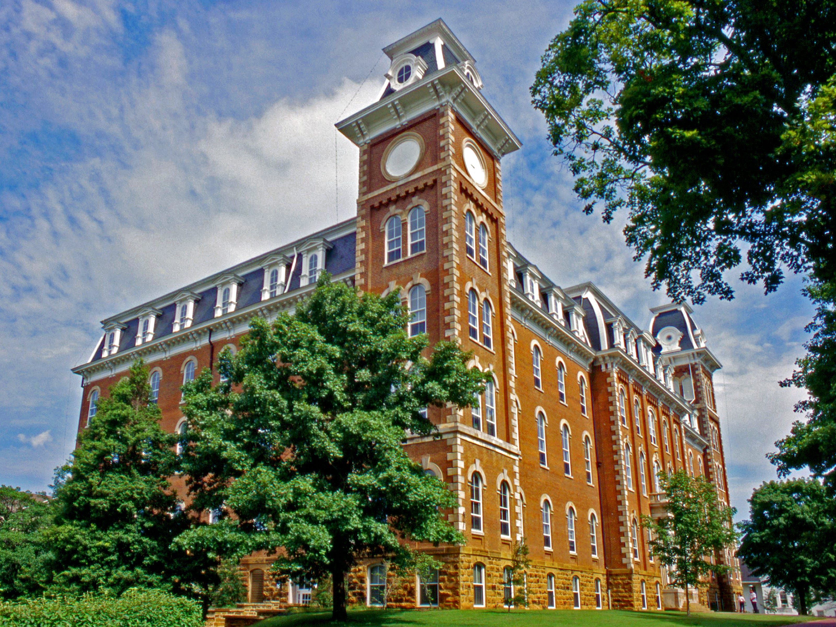 Arkansas: Old Main was the first permanent building erected on the University of Arkansas campus. The south tower contains a clock and the north tower houses the bell.